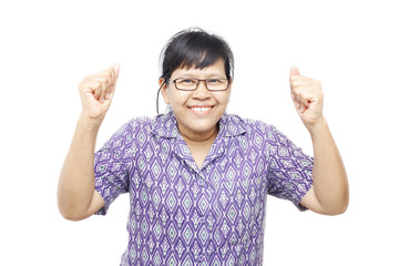 Asia woman with both arms up in air showing jubilation