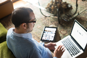 elegant business multitasking multimedia man at home
