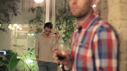 Relationship difficulties, young pensive couple drinking  wine