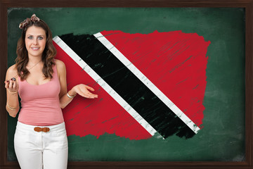 Beautiful and smiling woman showing flag of Trinidad and Tobago