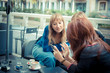 three friends woman at the bar using phone