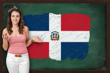 Beautiful and smiling woman showing flag of The Dominican Republ