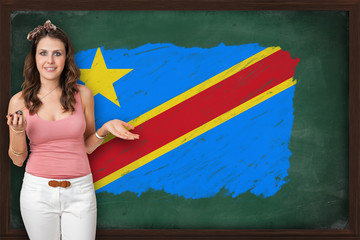 Beautiful and smiling woman showing flag of Democratic republic