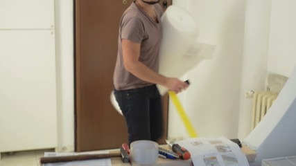 young man bricolage working at home