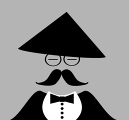 asian man wearing tuxedo and traditional conical hat