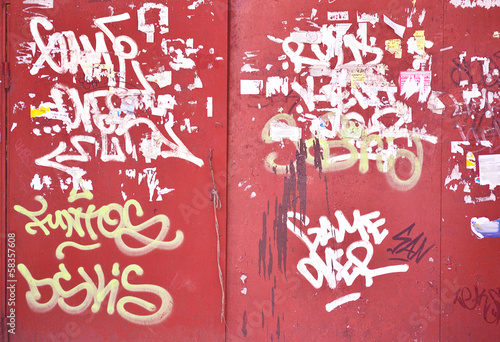 old iron gate with graffiti