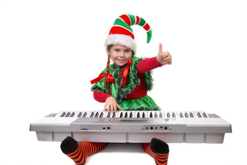 Girl Santa's elf plays a synthesizer