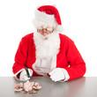 Santa breaking poor piggy bank