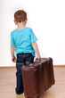 canvas print picture - Child with suitcase