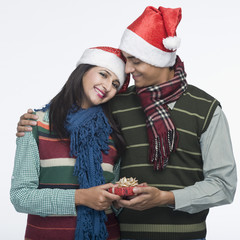 Man giving Christmas present to a woman