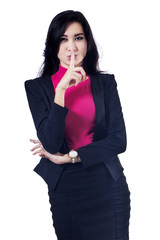 Businesswoman making a silence gesture