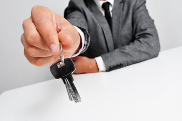 man in suit giving the keys