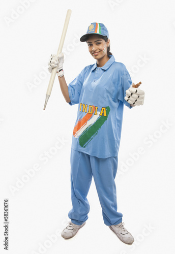 Portrait of a female cricketer holding a cricket stump and cheering