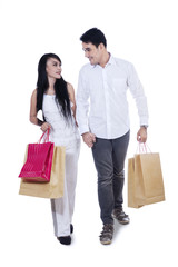 Romantic couple with shopping bags