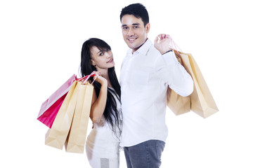 Young couple brings shopping bags