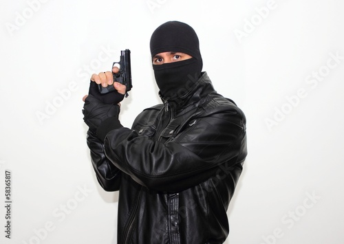 Masked hitman with the hand gun