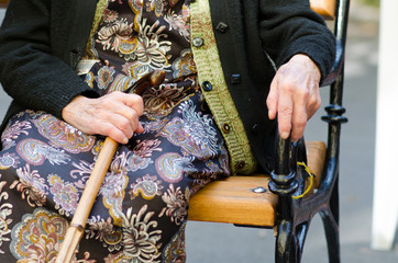 Senior woman with a cane