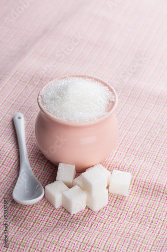 Sugar on pink background.