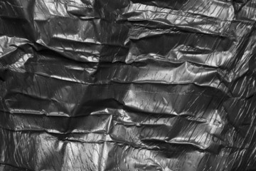 background of black polyethylene. texture