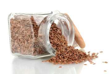 flax seeds in glass jar isolated on white