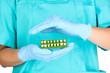 Denture holding dentist hands in blue medical gloves