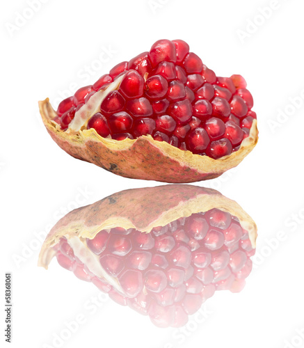 pomegranate with reflection on white background