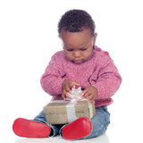Adorable African American child playing with a gift box