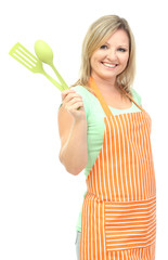 Woman with spoon and spatula, isolated on white