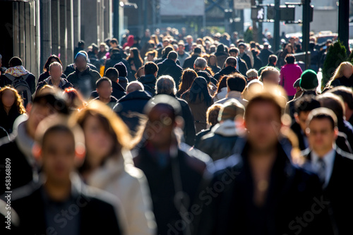 Anonymous crowd of people walking on city street - 58368809