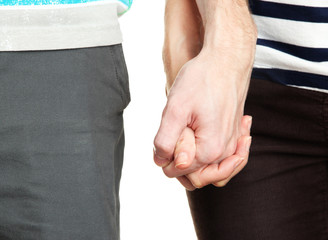 Couple holding hands close up