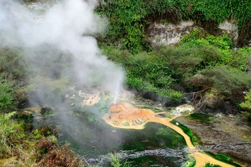 Steaming geo-thermal crater and lake in Waimangu Thermal Park