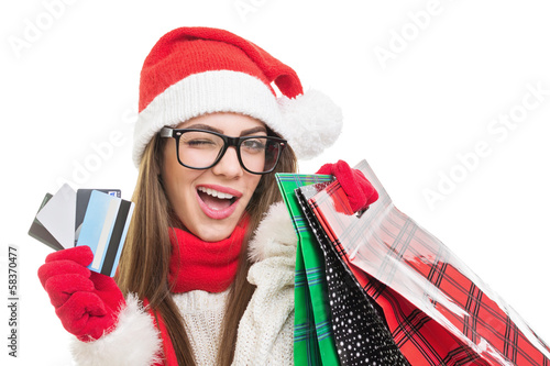 Cute young woman Christmas shopping