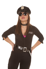 Woman cop glasses hands on hips