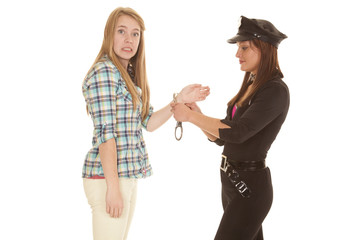 Woman cop handcuff woman upset