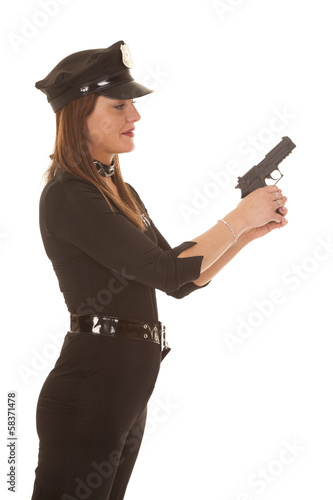 Woman cop hold pistol side
