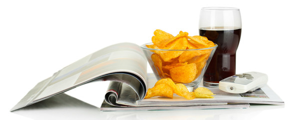 Chips in bowl, cola and TV remote isolated on white