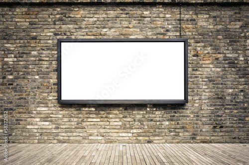 blank billboard on old brick wall