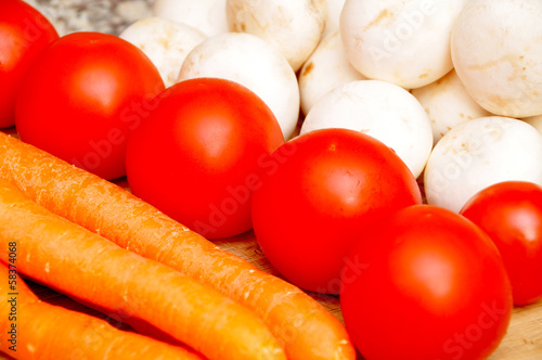 Fresh vegetables, mushrooms, carrots and tomatoes