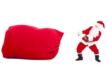 santa claus pulling a big gift  bag