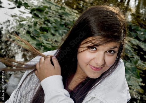 Young smiling brunette with long hair