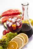 cold sangria with ice and various fruits