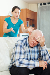 Upset senior man against angry wife
