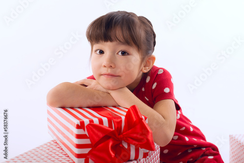 Picture of beautiful asian little girl with gift boxes