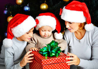 Mother and children with new year gift on the christmas holiday