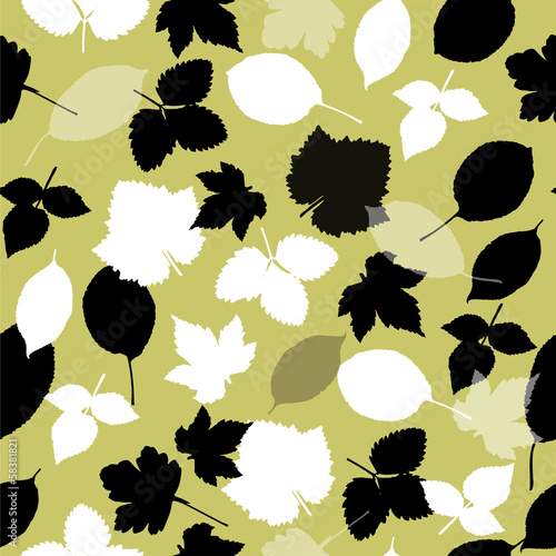 Seamless pattern with garden leaves on light green background