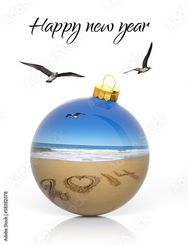 Christmas ball with 2014 written on sandy beach