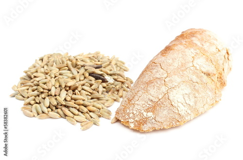 Rye grain and slice of bread on white background