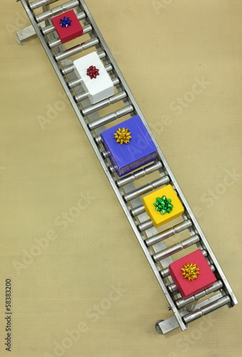 boxes on conveyor belt in Christmas gifts factory