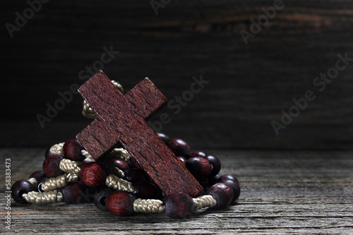 Wooden rosary on wooden table