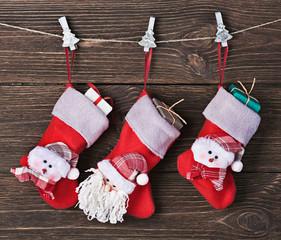 Christmas socks with gifts hanging